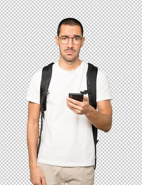 Étudiant Triste à L'aide D'un Téléphone Portable PSD Premium