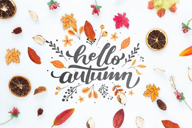 Feuilles d'automne séchées avec bonjour automne citation Psd gratuit