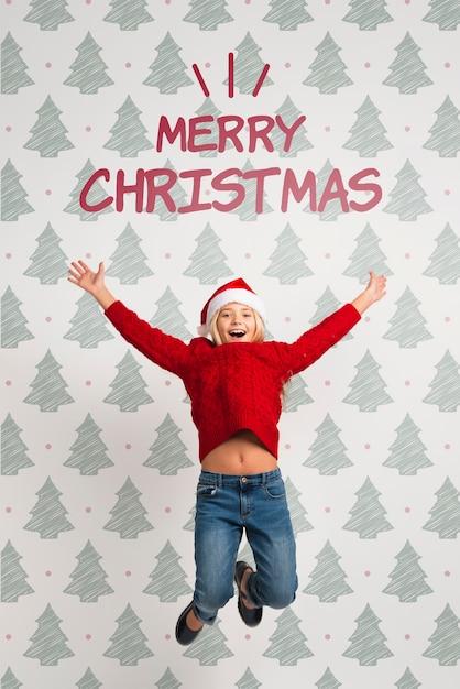 Fille Habillée En Rouge Pour Le Saut De Noël Psd gratuit