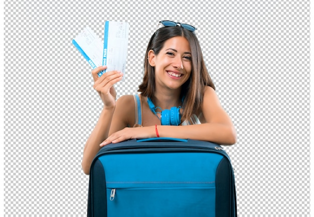 Fille voyageant avec sa valise détenant des billets d'avion PSD Premium
