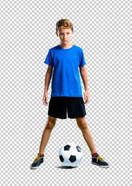 Garçon jouant au football PSD Premium