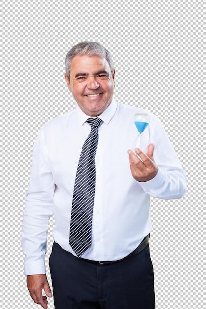 Heureux homme mûr tenant un sablier PSD Premium