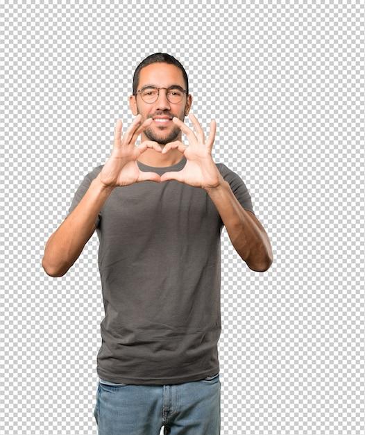 Heureux jeune homme fait un geste d'amour avec ses mains PSD Premium