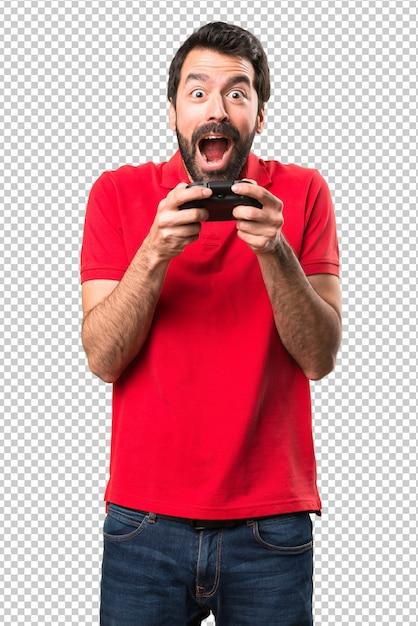 Heureux jeune homme jouant à des jeux vidéo PSD Premium