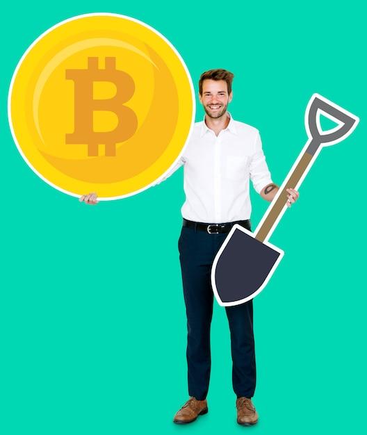 Homme d'affaires détenant des icônes de concept de crypto-monnaie et l'exploitation minière bitcoin PSD Premium