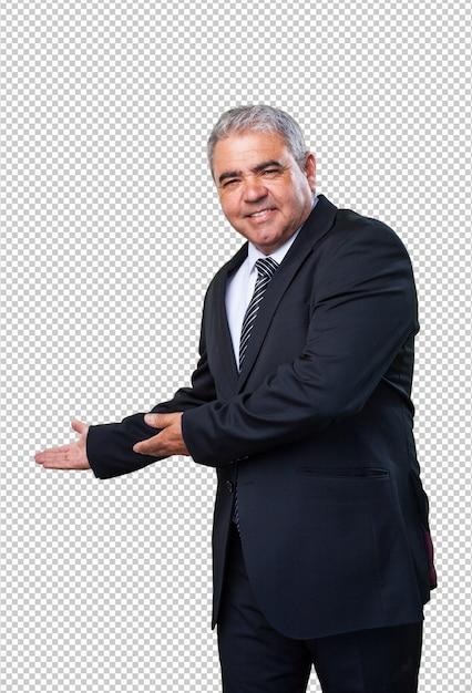 Homme d'affaires faisant un geste de bienvenue PSD Premium