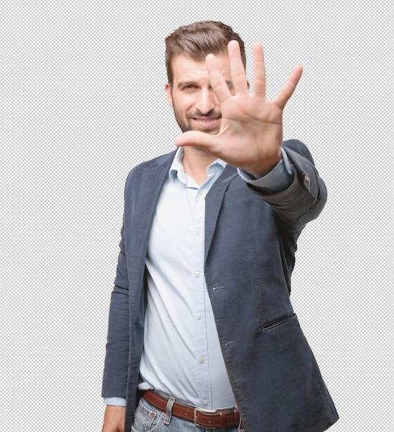 Homme D'affaires Montrant Cinq Doigts PSD Premium