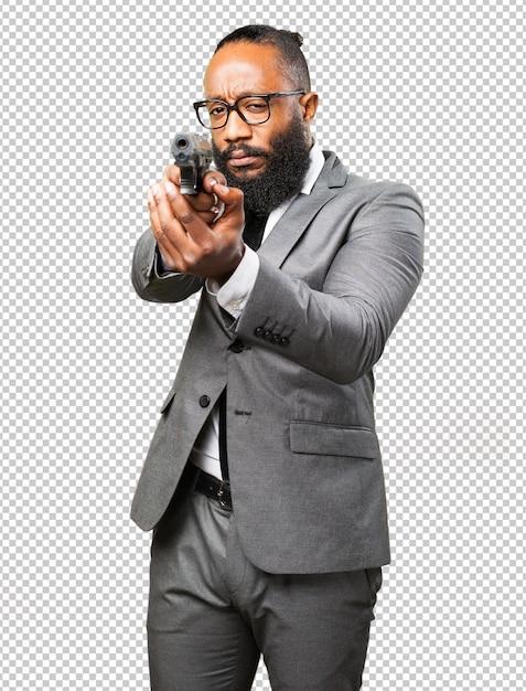 Homme d'affaires noir tenant une arme à feu PSD Premium