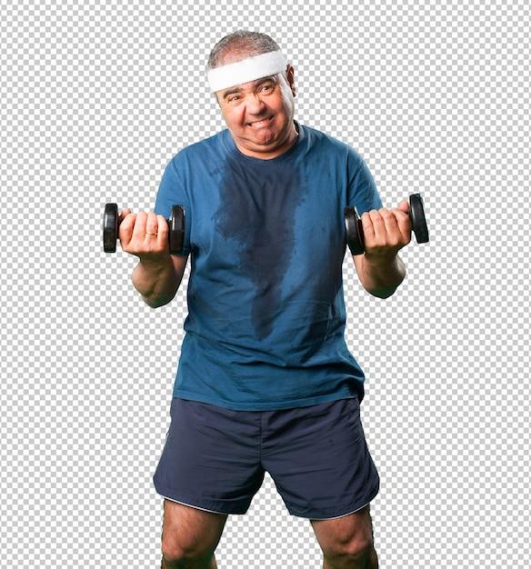 Homme d'âge moyen, faire des exercices avec des haltères PSD Premium