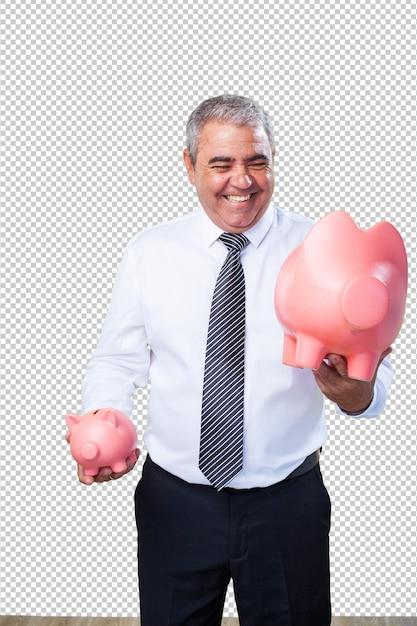 Homme d'âge mûr épargne avec tirelire PSD Premium