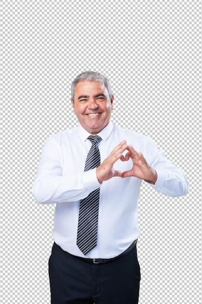Homme d'âge mûr faisant un symbole du coeur PSD Premium