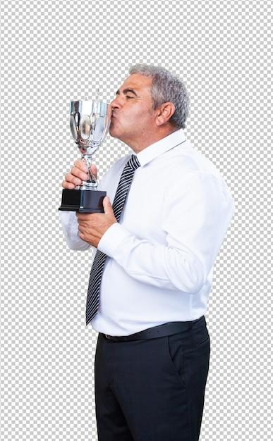 Homme d'âge mûr fier de son trophée PSD Premium