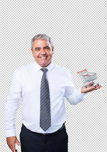Homme d'âge mûr tenant un caddie PSD Premium