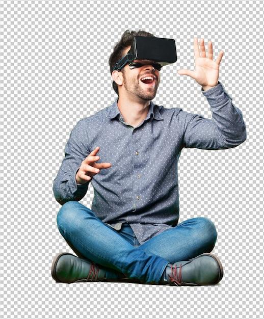 Homme assis sur le sol portant des lunettes de réalité virtuelle PSD Premium