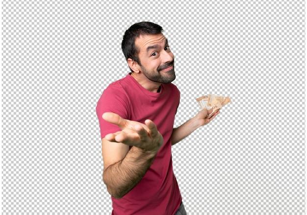 Homme prenant beaucoup d'argent, faisant un geste sans importance tout en soulevant les épaules PSD Premium