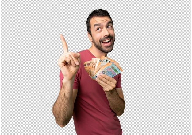 Homme prenant beaucoup d'argent pointant une excellente idée et levant les yeux PSD Premium