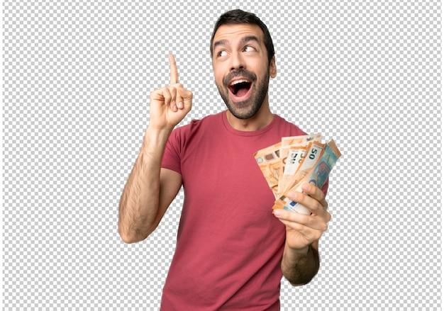 Un homme qui prend beaucoup d'argent dans l'intention de réaliser la solution tout en levant le doigt PSD Premium