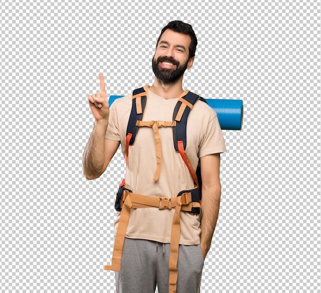 Homme de randonneur montrant et en levant un doigt en signe du meilleur PSD Premium