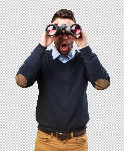 Homme regardant à travers des jumelles PSD Premium