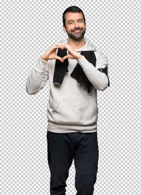Homme de sport faisant le symbole du coeur à la main PSD Premium
