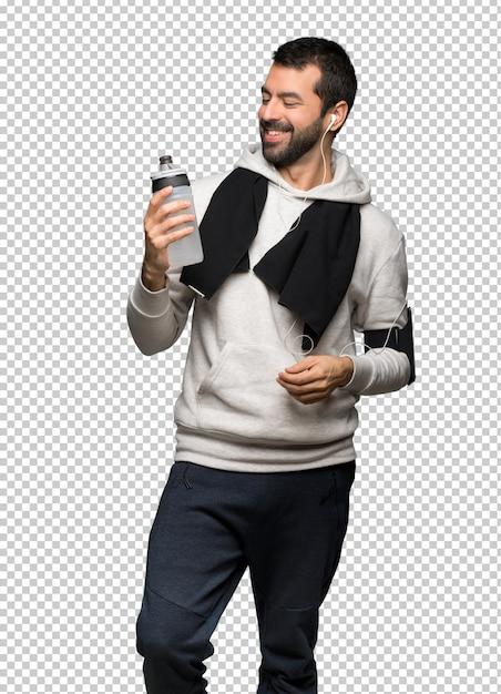 Homme de sport tenant une tasse de café PSD Premium