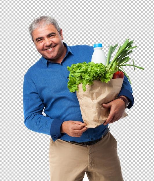 Homme tenant un sac de nourriture PSD Premium