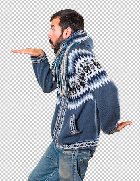 Homme avec des vêtements d'hiver dansant PSD Premium