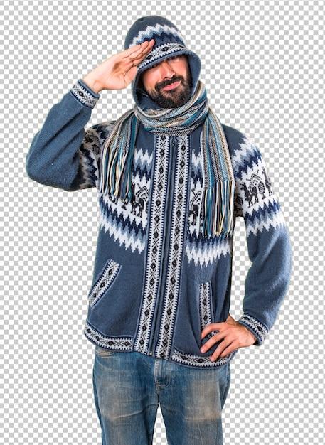 Homme avec des vêtements d'hiver saluant PSD Premium