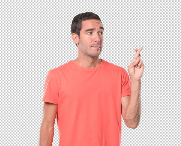 Inquiet de jeune homme avec le geste des doigts croisés PSD Premium