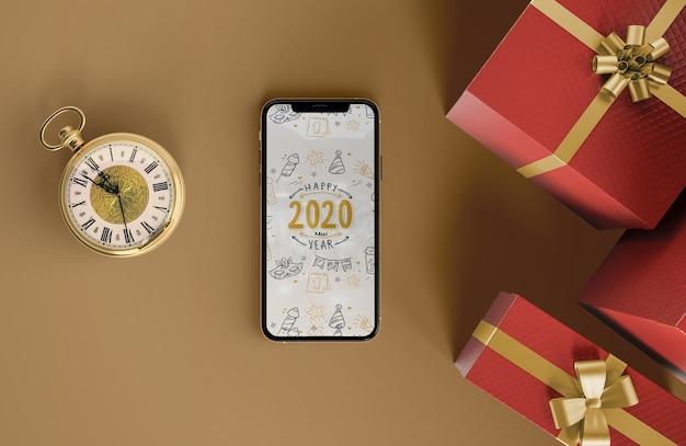 Iphone Maquette Avec Des Cadeaux Psd gratuit