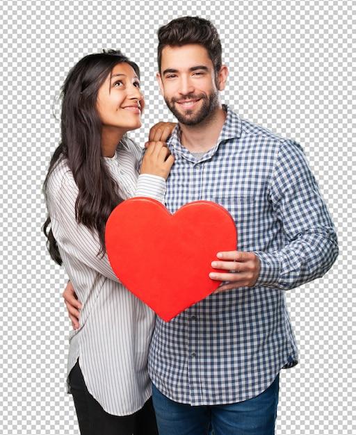 Jeune couple tenant un coeur rouge PSD Premium