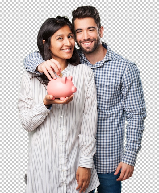 Jeune couple tenant une tirelire PSD Premium