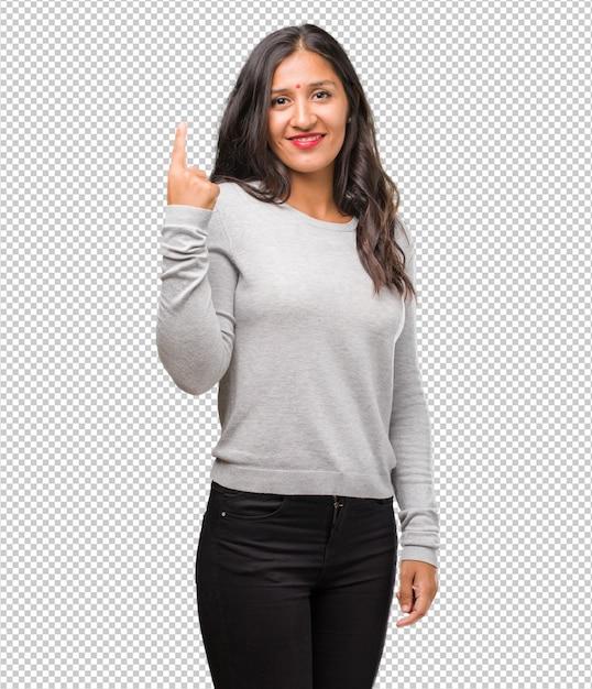 Jeune Femme Indienne Montrant Le Numéro Un PSD Premium