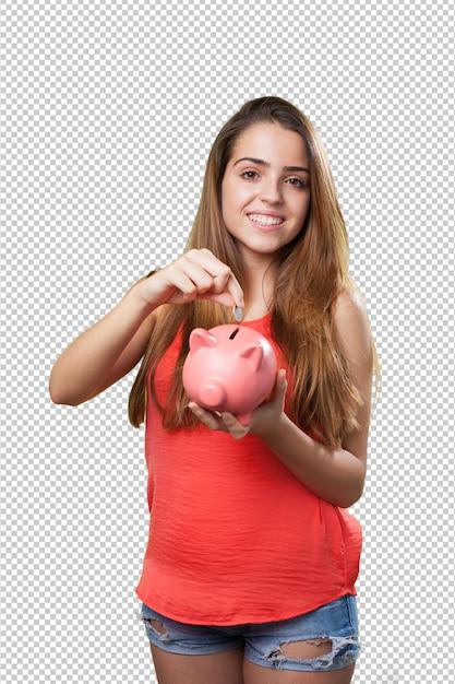 Jeune femme mignonne épargne avec une tirelire PSD Premium