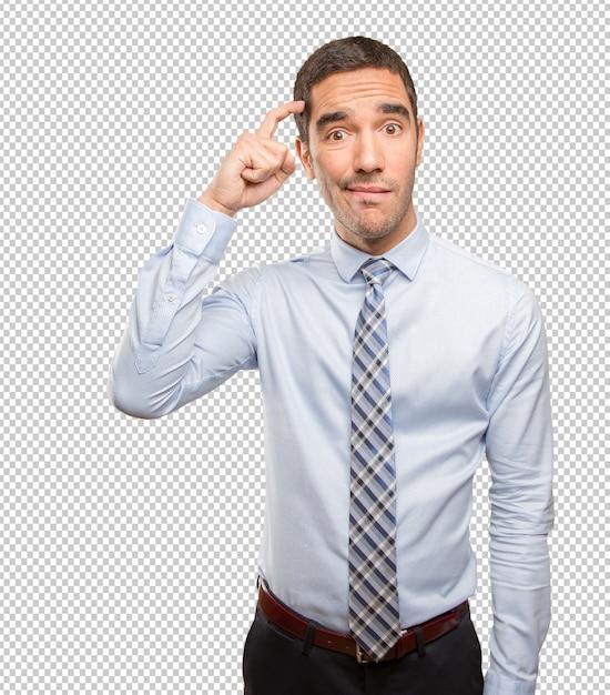 Jeune homme d'affaires perplexe faisant un geste de doute PSD Premium