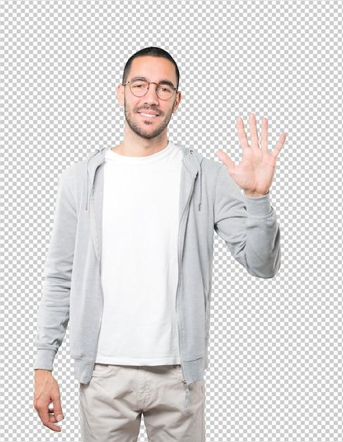 Jeune Homme Faisant Un Geste Numéro Cinq PSD Premium