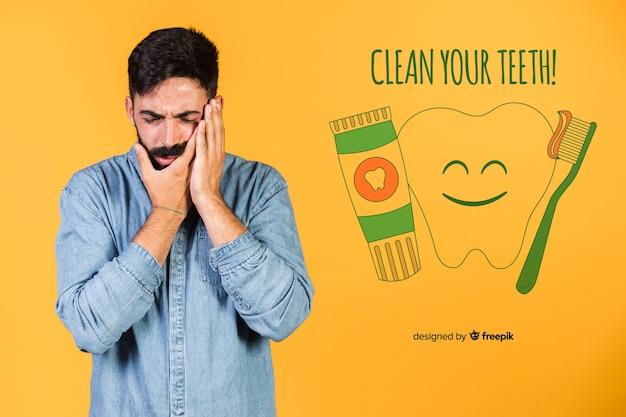 Jeune homme montrant ses dents dents avec message Psd gratuit