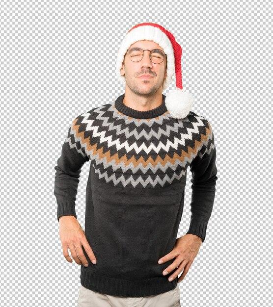 Jeune Homme Portant Un Chapeau De Noël Tout En Faisant Des Gestes Isolés PSD Premium