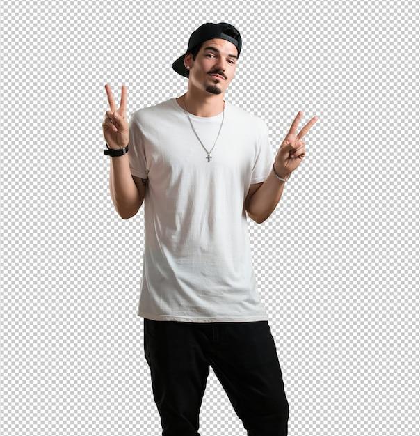 Jeune Homme Rappeur Amusant Et Heureux, Positif Et Naturel, Fait Un Geste De Victoire PSD Premium