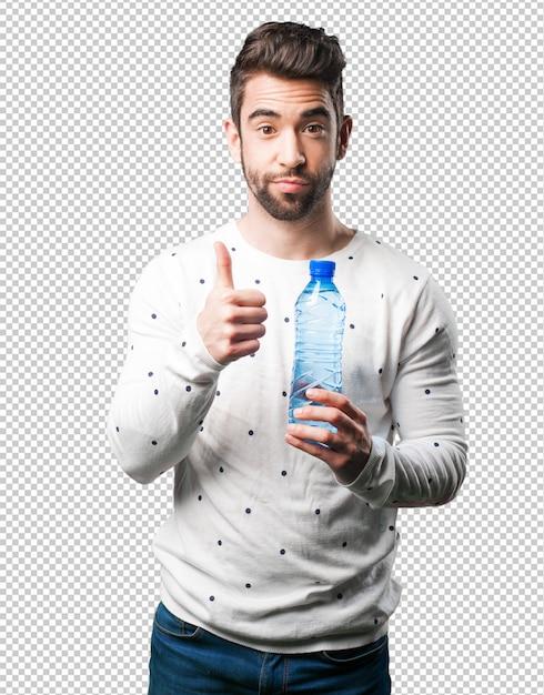 Jeune homme tenant une bouteille d'eau PSD Premium