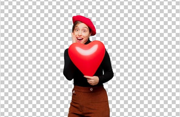 Jeune jolie femme exprimant le concept de l'amour pour la saint valentin PSD Premium