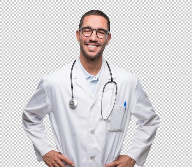Jeune médecin satisfait posant PSD Premium