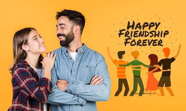 Joli jeune couple à côté d'un message dessiné à la main Psd gratuit