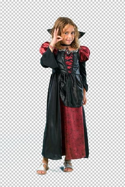 Kid habillé comme un vampire lors des fêtes d'halloween montrant un signe ok avec les doigts PSD Premium