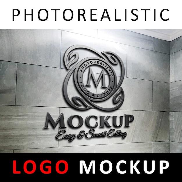 Logo maquette - logo métallique en acier noir 3d sur le mur en marbre PSD Premium
