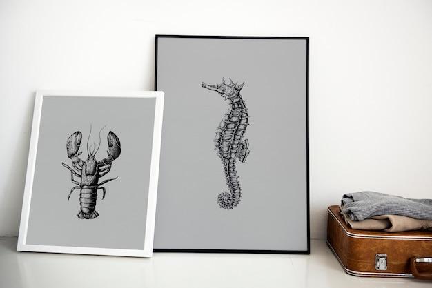 Main, dessin photo hippocampe dans le cadre photo PSD Premium