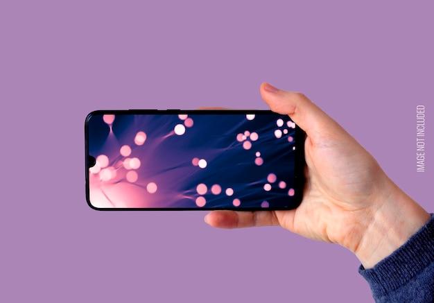 Main Droite Tenant Une Maquette De Smartphone Horizontal Psd gratuit