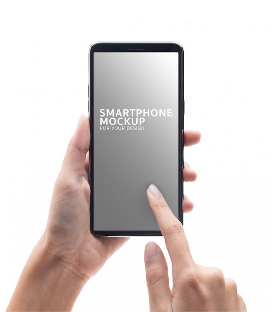 Main de femme tenant maquette smartphone noir et touchant. PSD Premium