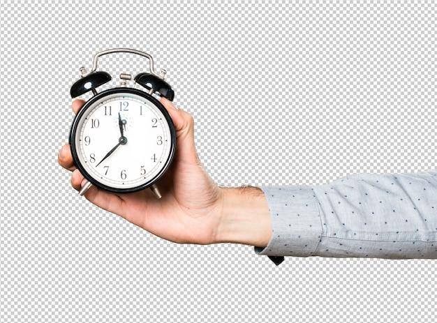 Main d'homme tenant une horloge vintage PSD Premium