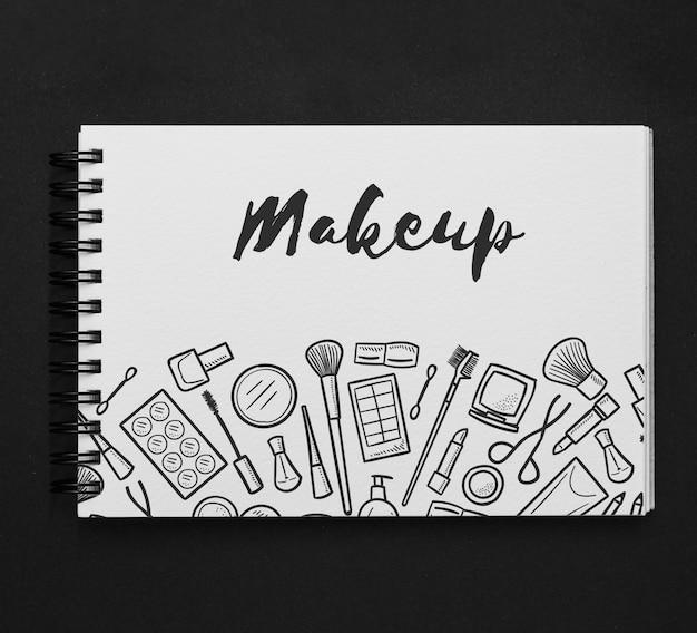 Maquette de bloc-notes horizontal avec dessin de maquillage Psd gratuit